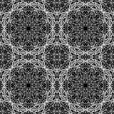 Белая картина орнамента на черной предпосылке стоковое фото rf