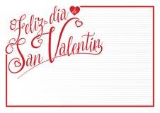 Белая карточка с красной границей с сообщением FELIZ DIA DE САН VALENTIN - счастливым днем ` s валентинки в испанском языке Стоковые Изображения