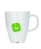 Белая чашка чая с пакетиком чая стоковая фотография