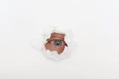 белизна бумаги отверстия глаза Стоковая Фотография RF