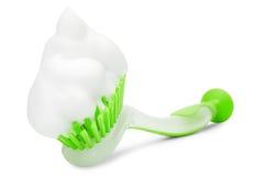 белизна зеленого цвета пены чистки щетки Стоковое Изображение