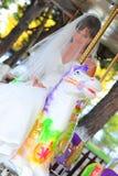 белизна лошади carousel невесты Стоковое Изображение RF