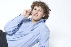 белизна мобильного телефона мальчика Стоковые Изображения