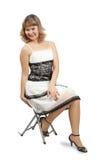 белизна платья изолированная девушкой сидя Стоковая Фотография RF