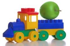 белизна поезда игрушки предпосылки пластичная Стоковые Изображения RF