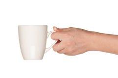 белизна руки чашки стоковые изображения rf