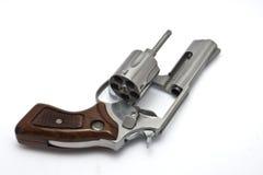 белизна серебра револьвера предпосылки Стоковая Фотография RF