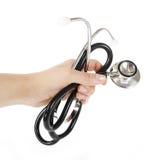 белизна стетоскопа доктора изолированная рукой Стоковое Изображение