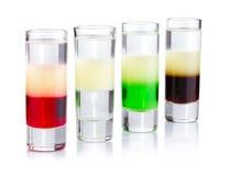 белизна съемки питья 4 коктеилов изолированная Стоковое фото RF