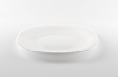 белизна тарелки пустая Стоковое фото RF