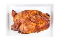белизна тарелки цыпленка зажженная зажаренная в духовке половиной Стоковое Изображение RF