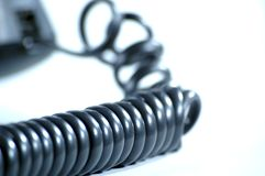 белизна телефона кабеля с черной пропиткой предпосылки Стоковое фото RF