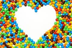 белизна формы сердца конфеты предпосылки Стоковые Изображения