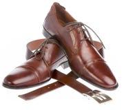белизна человека s ботинка предпосылки Стоковые Фото