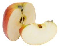 белизна яблока отрезанная предпосылкой красная Стоковые Изображения
