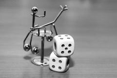 Белизна 2 dices и игрушка металла Стоковое Фото