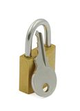 белизна padlock ключа предпосылки Стоковое фото RF