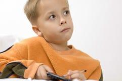 белизна palmtop мальчика Стоковое Фото