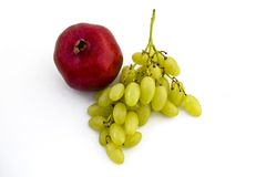 белизна pomegranate виноградин предпосылки стоковое изображение