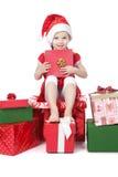белизна santa шлема девушки подарков маленькая Стоковое фото RF