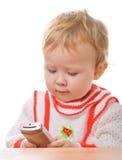 белизна smartphone малыша стоковые изображения rf