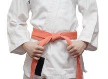 Белое кимоно и померанцовый пояс Стоковое Фото