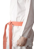 Белое кимоно и померанцовый пояс Стоковая Фотография