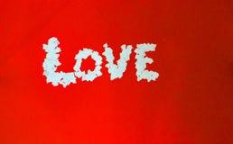 Белое сердце от бумаги на красной предпосылке Стоковые Фотографии RF