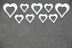 Белое чистое сердце на серой предпосылке для всех любовников Стоковая Фотография