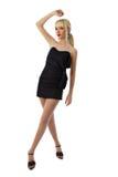 Белокурая девушка в черной меньшее платье Стоковые Фотографии RF