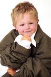 белокурое дело мальчика одевает сверхразмерных детенышей Стоковая Фотография RF