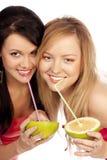 белокурый сок питья цитруса брюнет Стоковая Фотография