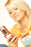 белокурый телефон девушки клетки Стоковая Фотография RF