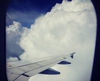 Белые облака от плоского окна Стоковая Фотография RF