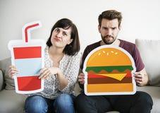 Белые пары с значками еды Стоковая Фотография