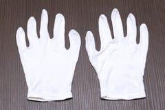 белые перчатки хлопка Стоковая Фотография