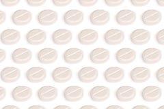 Белые пилюльки изолированные на белизне Стоковые Фото