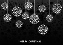 Белые шарики Xmas на черной предпосылке Стоковые Изображения