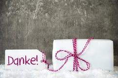 Белый подарок, снег, ярлык, середины Danke спасибо Стоковые Фотографии RF