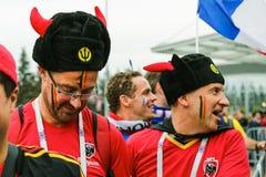 Бельгийские вентиляторы в традиционных костюмах Стоковое фото RF