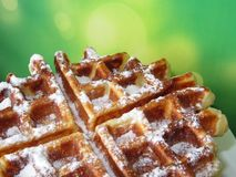 Бельгийские waffles на предпосылке запачканной зеленым цветом Десерт с космосом бесплатной копии Стоковые Изображения