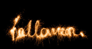 Бенгальские огни знака хеллоуина на черной предпосылке Стоковая Фотография