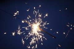 Бенгальские огни на синей предпосылке Стоковая Фотография