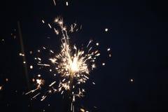 Бенгальские огни на синей предпосылке Стоковые Фото