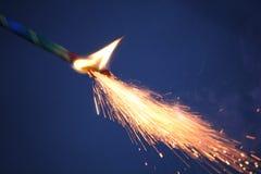 Бенгальские огни на синей предпосылке Стоковые Изображения
