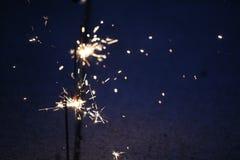 Бенгальские огни на синей предпосылке Стоковое Фото