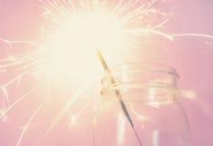 Бенгальский огонь в бутылке на розовой предпосылке Стоковое Изображение RF