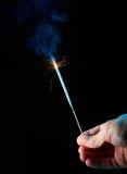 Бенгальский огонь в руке Стоковые Фото
