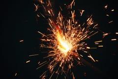 Бенгальский огонь на темной предпосылке Стоковая Фотография