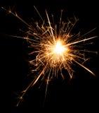 Бенгальский огонь партии рождества и Нового Года на черноте Стоковая Фотография